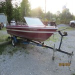 15 feet boat, motor and trailer